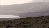 Panning shot of A hazy Dead Sea shoreline shot in Israel.