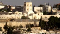 Panning shot of A cemetery and the Rockefeller Museum filmed in Israel.