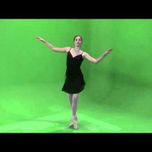 Shot of a ballerina in black dancing on a green screen.