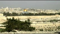 Panning shot of Jewish Cemetery and Old Jerusalem at sunrise filmed in Israel.