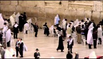 Panning shot of Jews praying at the Western Wall filmed in Israel.