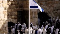 Panning shot of Jews at the Western Wall filmed in Israel.