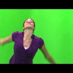 Girl in a purple shirt dancing on a green screen.
