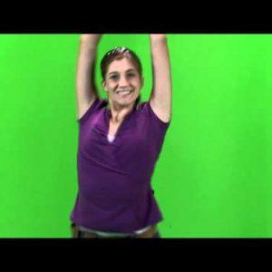 Girl dancing on a green screen in a purple shirt.