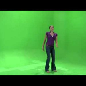 Clip of a girl dancing on a green screen in a purple shirt.