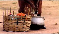 African Woman cleaning dishes.