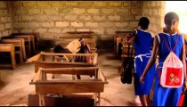 African children cleaning their classroom.