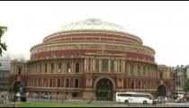 Cars drive past Royal Albert Hall in London.
