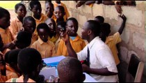 Royalty Free Stock Footage of Teacher teaching children in Africa.