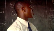 Royalty Free Stock Footage of Teacher writing on a blackboard in Africa.