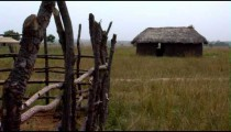 Royalty Free Stock Footage of A grassy hut and fence in Africa.