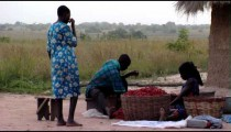 Royalty Free Stock Footage of A family with a basket of chili peppers in Africa.