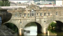 Stone covered bridge over a river in bath, England.