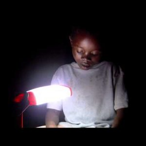 Royalty Free Stock Footage of African boy reading by a lamp.