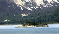 Time-lapse view passing by and around an island in a bay near Glacier Bay.