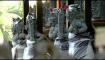 Rack focus of stone statues in Bali.