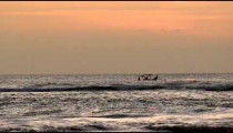 Fishing boat on the water at sunset in Bali.