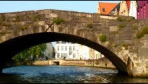 Colorful buildings and a bridge over a canal in Bruges Belgium.