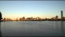 Boston cityscape from across the Charles River at sunset.