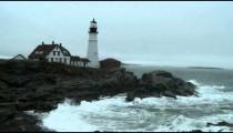 Portland Head Light on a rocky shore in Maine.