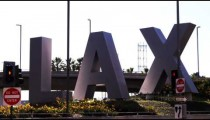 Los Angeles Airport (LAX) sign outside the airport.