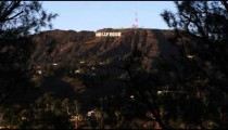 Pan to Hollywood sign in California.