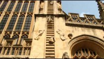 Tilt up shot of Jacob's Ladder sculpture on a church in Bath, England.