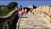 Woman walking down a decline at the Great Wall of China.