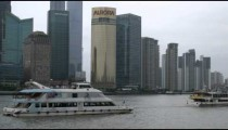 Boats floating by a harbor in Shanghai China.