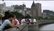 People standing at a pier in Shanghai China.