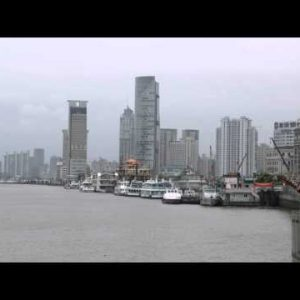 Clip of people standing at a pier in Shanghai China.