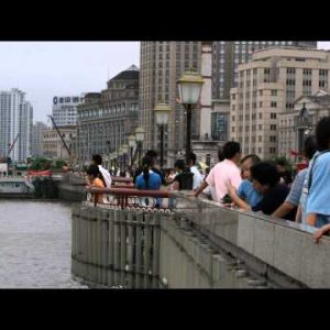 People standing at a dock in Shanghai China.