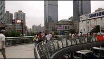 People walking in downtown Shanghai China.