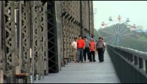 Family on a bridge in China.