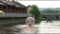 Giant plastic ball for walking on a river.