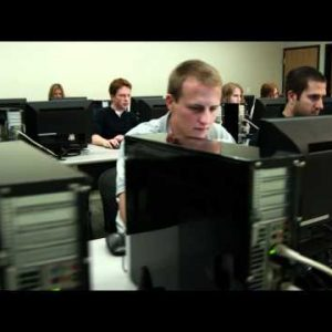 Dolly shot of people working on computers.