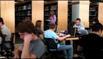 Wide shot of students studying at a library.