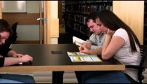 Clip of students studying at a library.