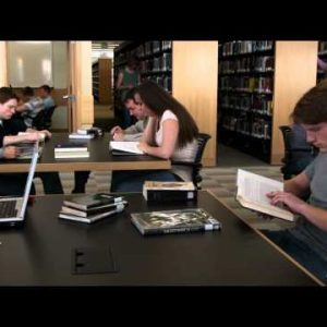 Shot of students studying at a library.