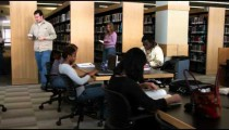 Students in a library studying.