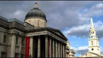 Buildings with dark clouds in the background in Trafalgar Square London.