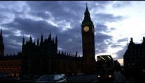 Silhouette of Big Ben with passing traffic in London.