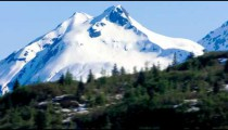 Traveling time-lapse view of a snow covered mountain in Glacier Bay, Alaska
