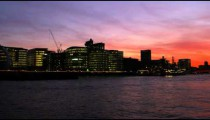 Pan of London cityscape after sunset.