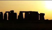 Wide shot pan of Stonehenge at sunset.