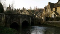 Royalty Free Stock Footage of Old stone village a stream and a bridge in England.