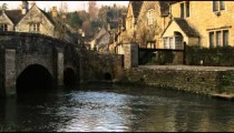 Royalty Free Stock Footage of Tilt from stream to stone village in England.