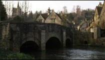 Royalty Free Stock Footage of Clip of a stone village bridge and stream in England.