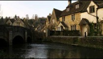 Royalty Free Stock Footage of Old stone village in England with a bridge and stream.