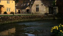 Royalty Free Stock Footage of Shot of a stream and an old stone building.